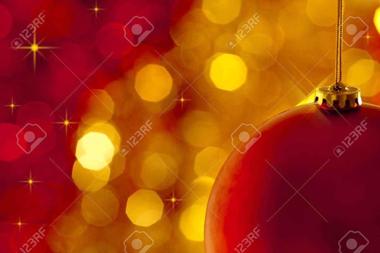 Christmas tree decoration on lights red and gold background Stock Photo - 10264354