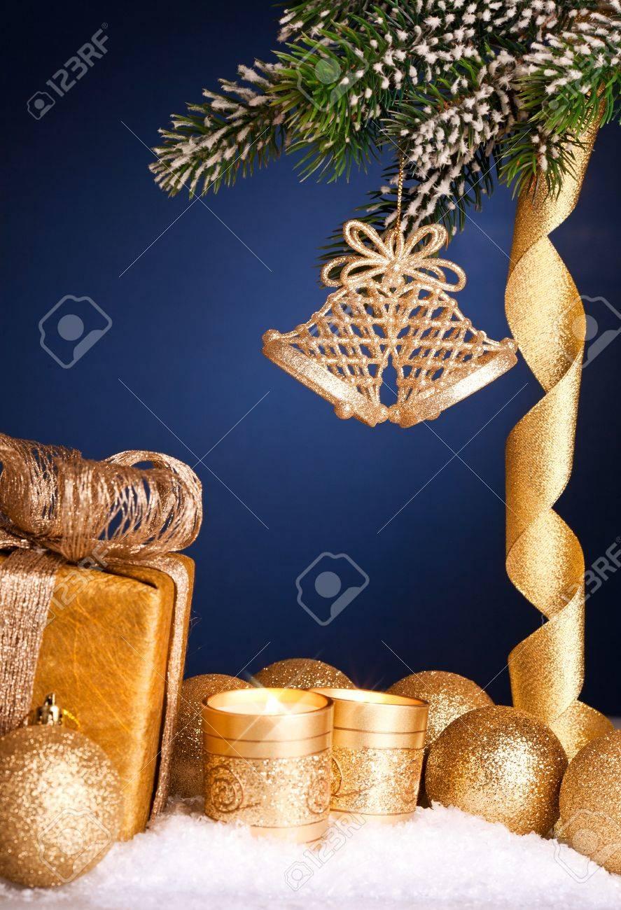 Dark blue christmas tree decorations - Christmas Tree Decorations In Snow On Dark Blue Background Shallow Depth Of Field Stock Photo