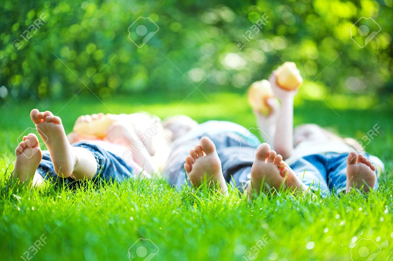 children laying on grass family picnic in spring park stock photo 11485730 - Spring Pictures For Children
