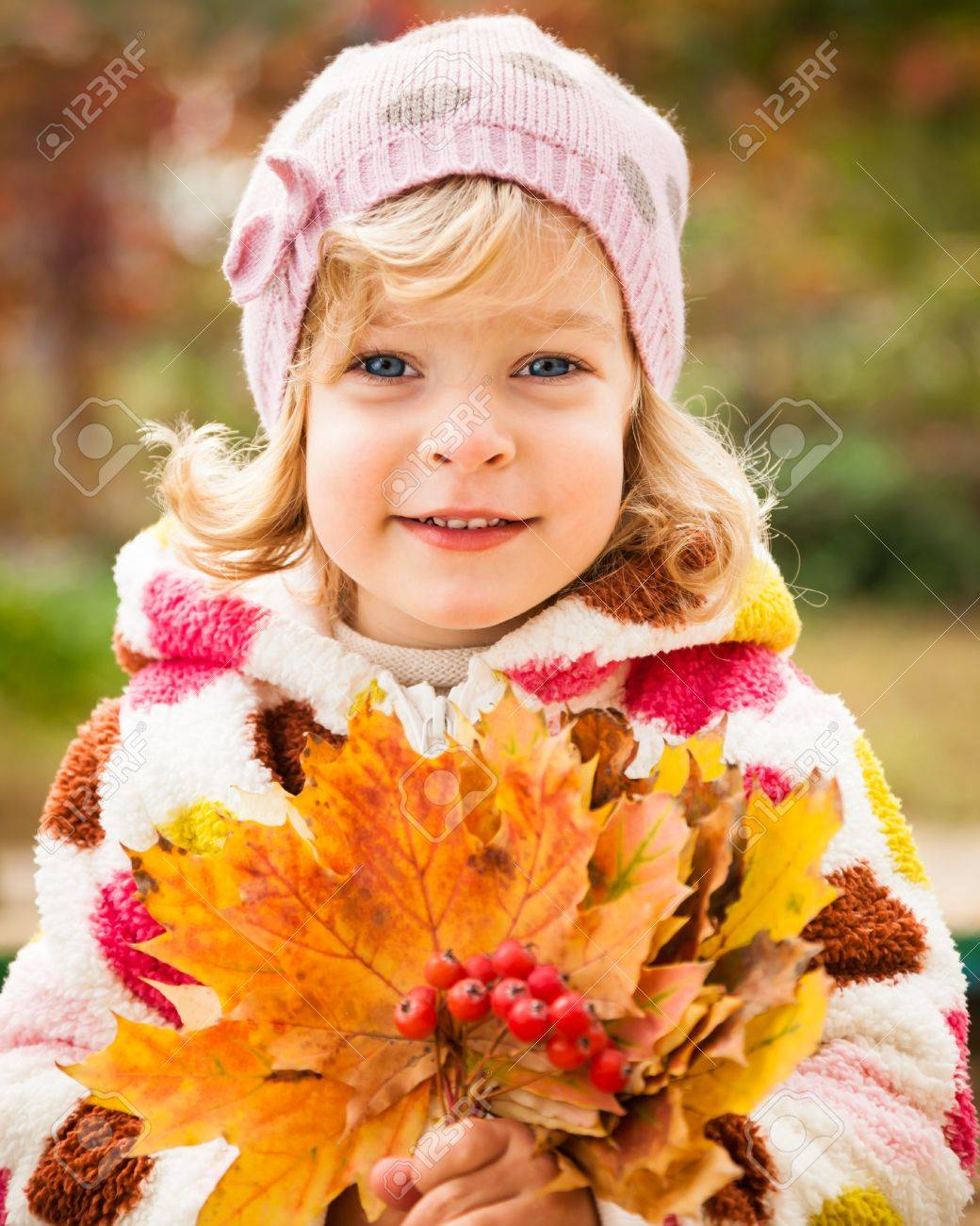 Happy smiling child holding yellow maple leaves in autumn park Stock Photo - 13881814