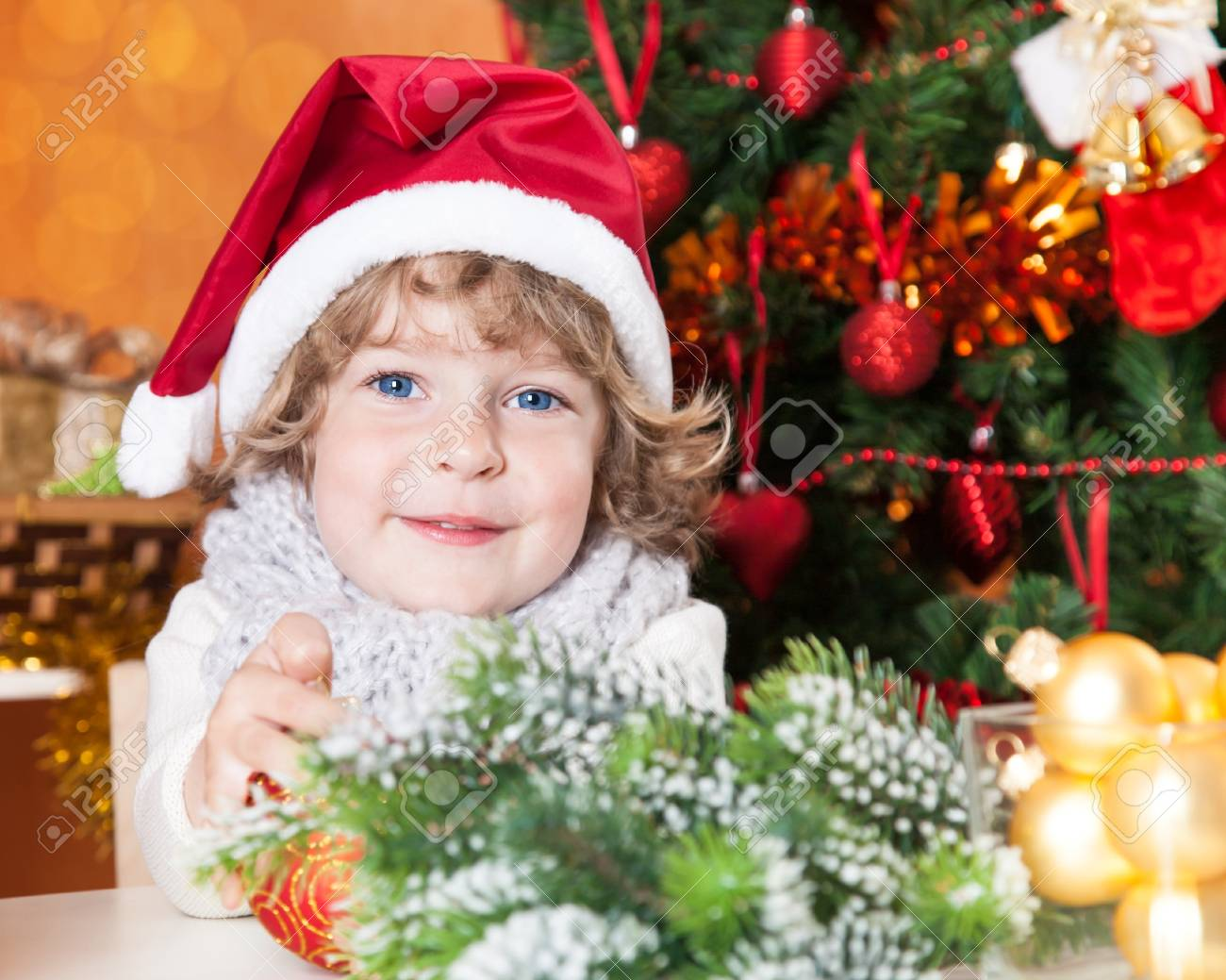 Happy child in Santa hat against Christmas tree with decorations Stock Photo - 14585702