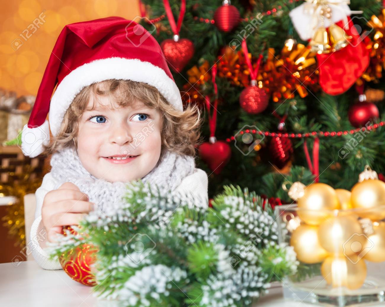 Happy child in Santa`s hat against decorated Christmas tree Stock Photo - 14585774