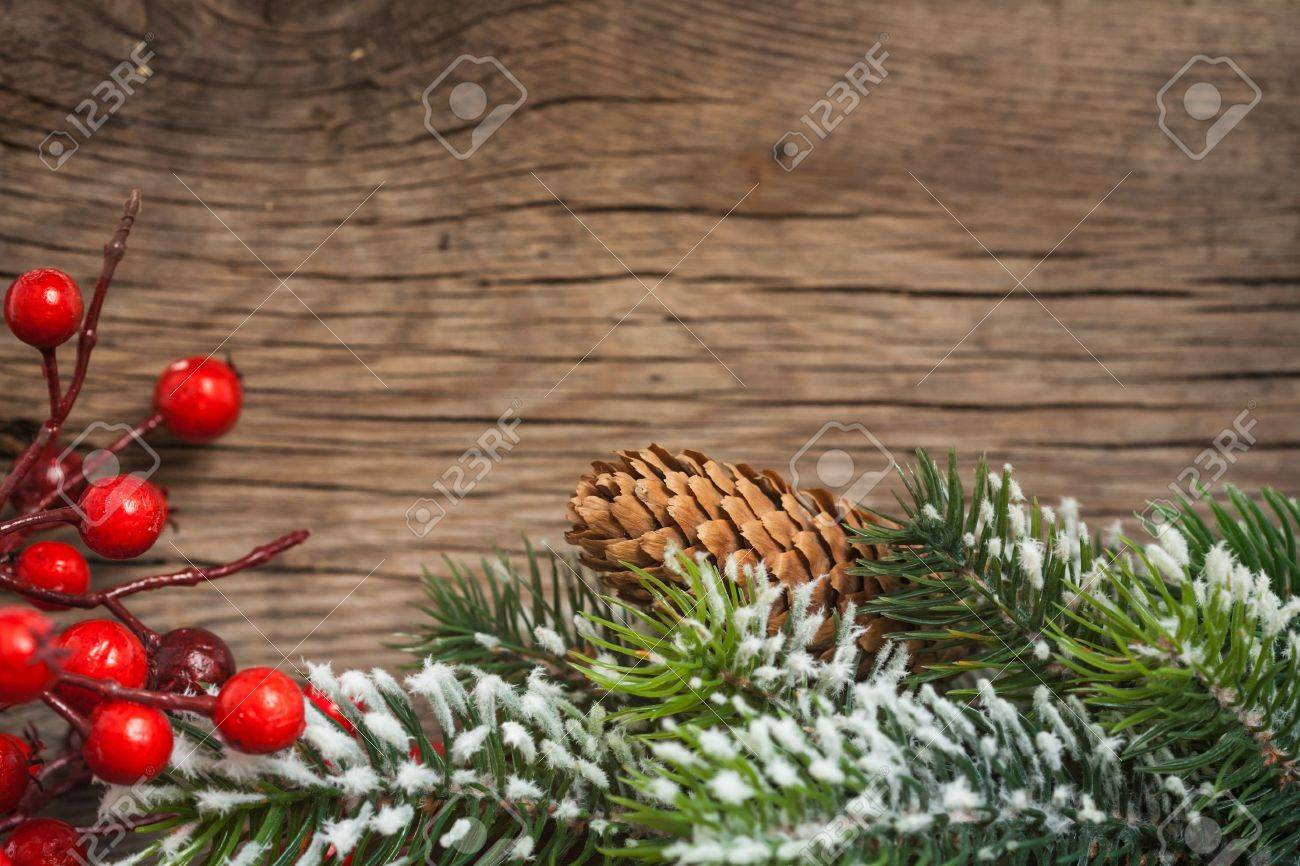 Border from branch of Christmas tree on wood Stock Photo - 14992770