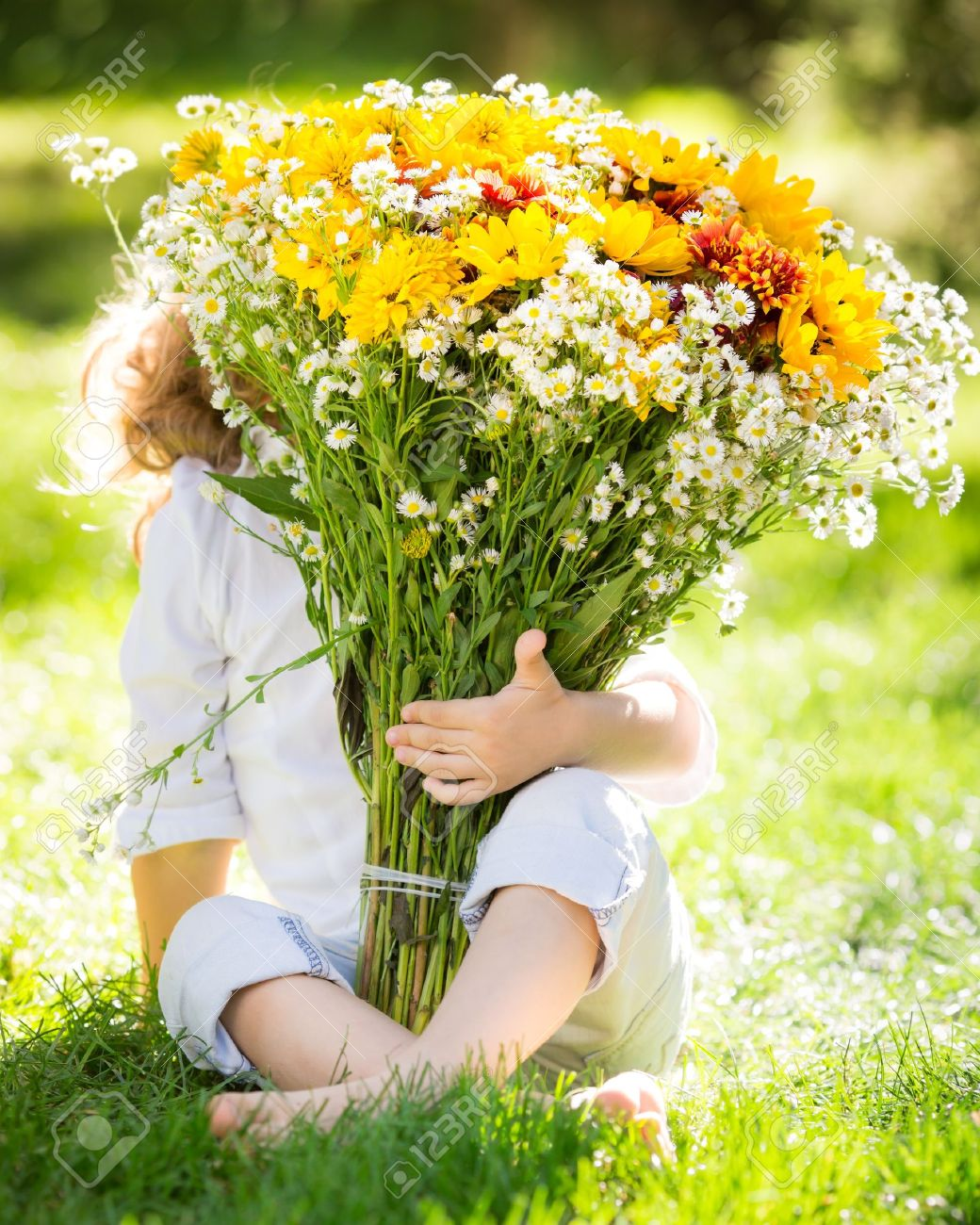Child hiding behind big bouquet of spring flowers outdoors stock child hiding behind big bouquet of spring flowers outdoors stock photo 17347879 mightylinksfo Images