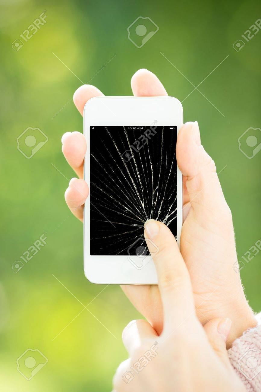 Woman holding smartphone with broken touchscreen Stock Photo - 17546624
