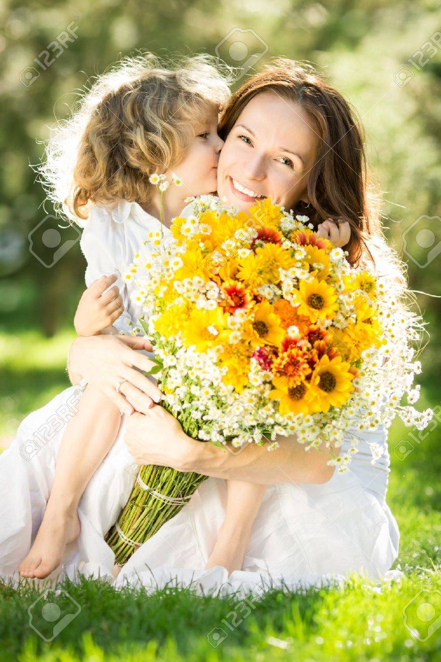 Happy child giving big bouquet of spring flowers to woman for mother`s day Stock Photo - 17793050