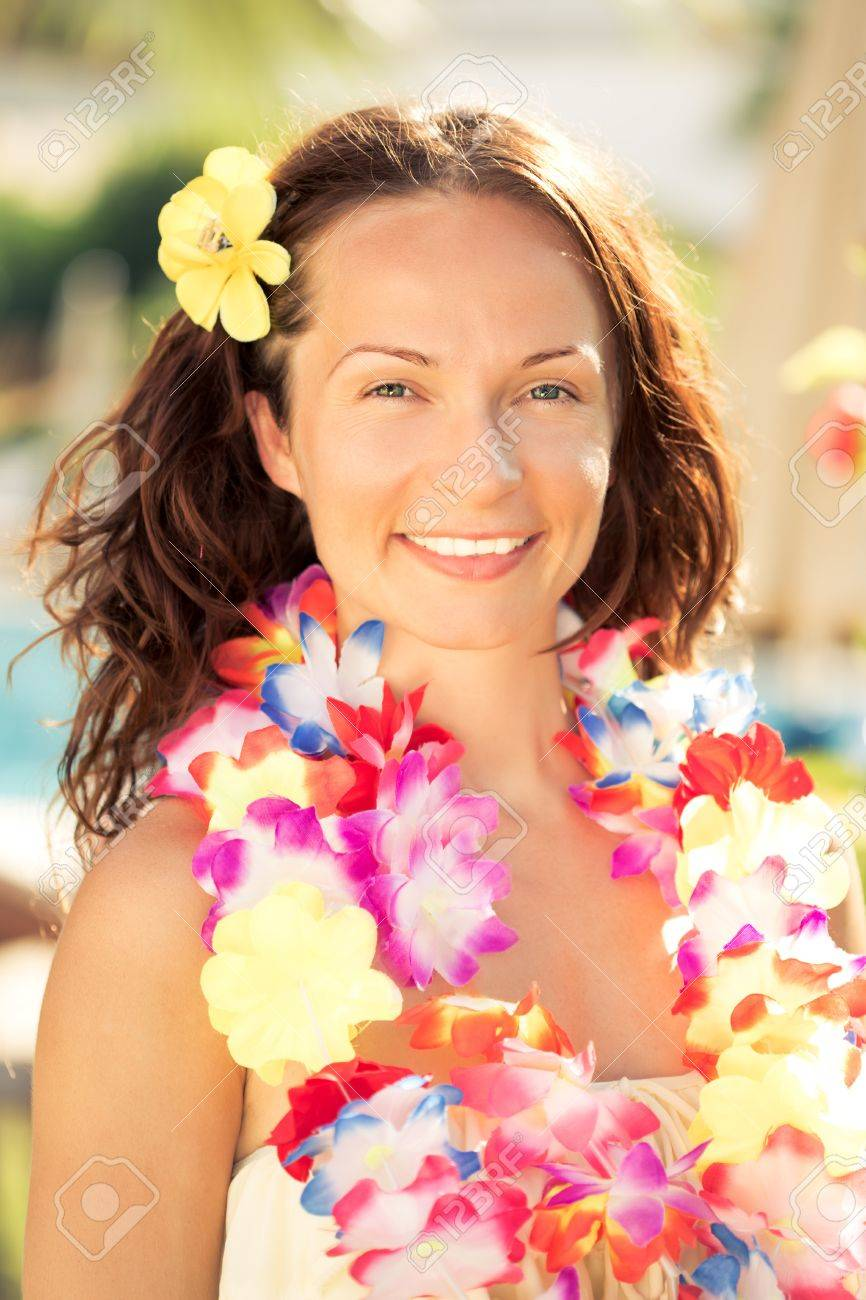 Young smiling woman in hawaiian flowers garland on the beach stock photo young smiling woman in hawaiian flowers garland on the beach summer vacations concept izmirmasajfo