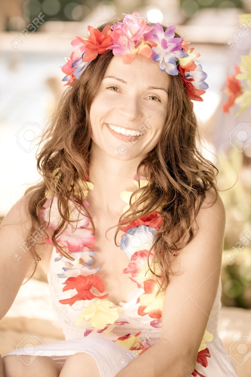 Happy smiling woman wearing hawaiian flowers garland on the beach happy smiling woman wearing hawaiian flowers garland on the beach summer vacations concept stock photo izmirmasajfo Images