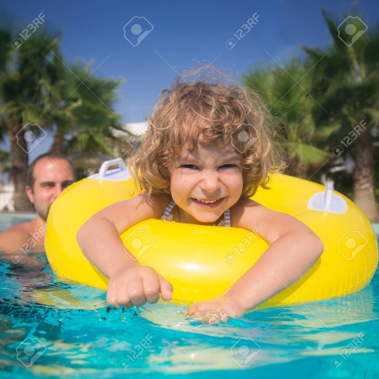 Happy child with father playing in swimming pool  Summer vacations concept Stock Photo - 19671093