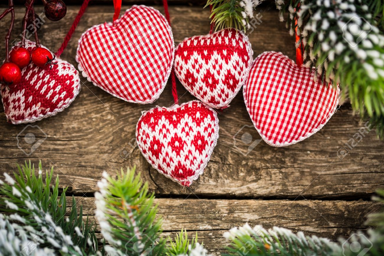 Christmas tree decorations hanging on branch against wooden. Winter holidays concept Stock Photo - 22437123