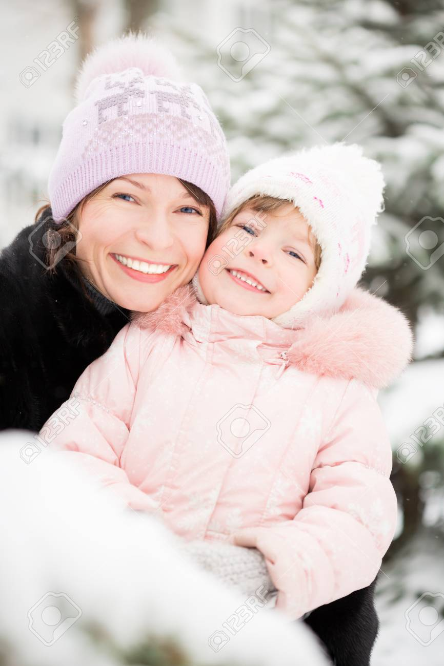 Happy family playing in winter outdoors Stock Photo - 22579160