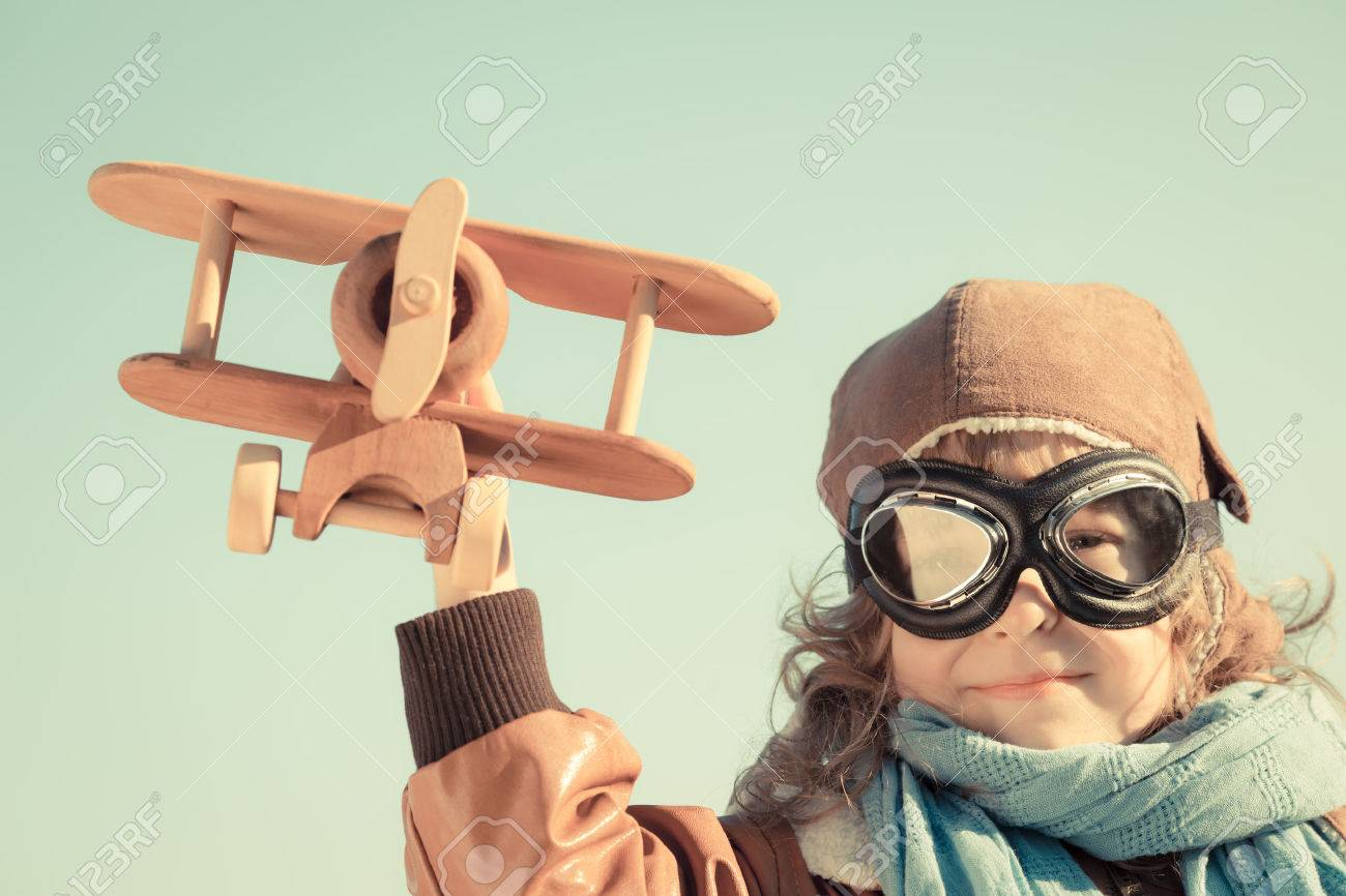 Happy kid playing with wooden toy airplane in autumn Stock Photo - 22918241