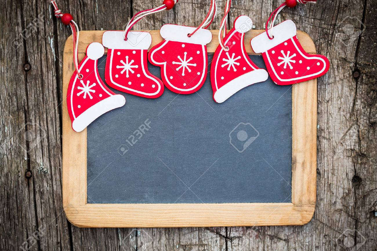 Christmas tree decorations border on vintage wooden blackboard  Winter holidays concept  Copy space for your text Stock Photo - 22918416