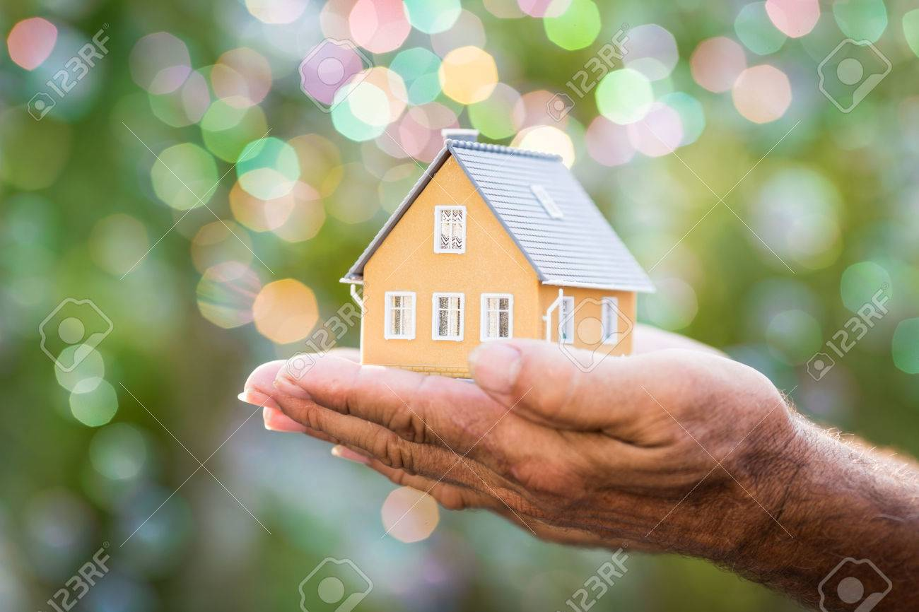 Ecology house in hands against spring blurred background Stock Photo - 25056697