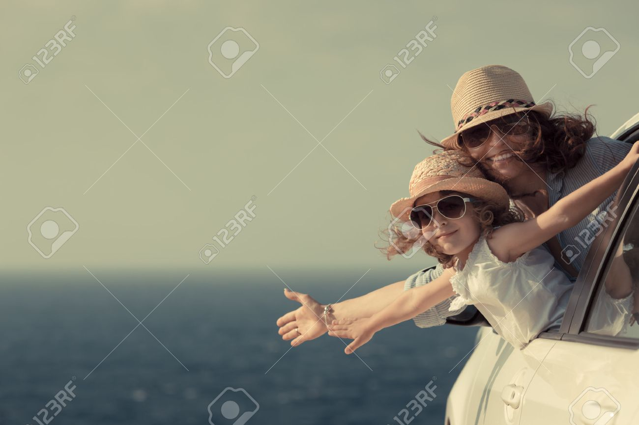 Woman and child at the beach. Summer vacations concept Stock Photo - 27162232