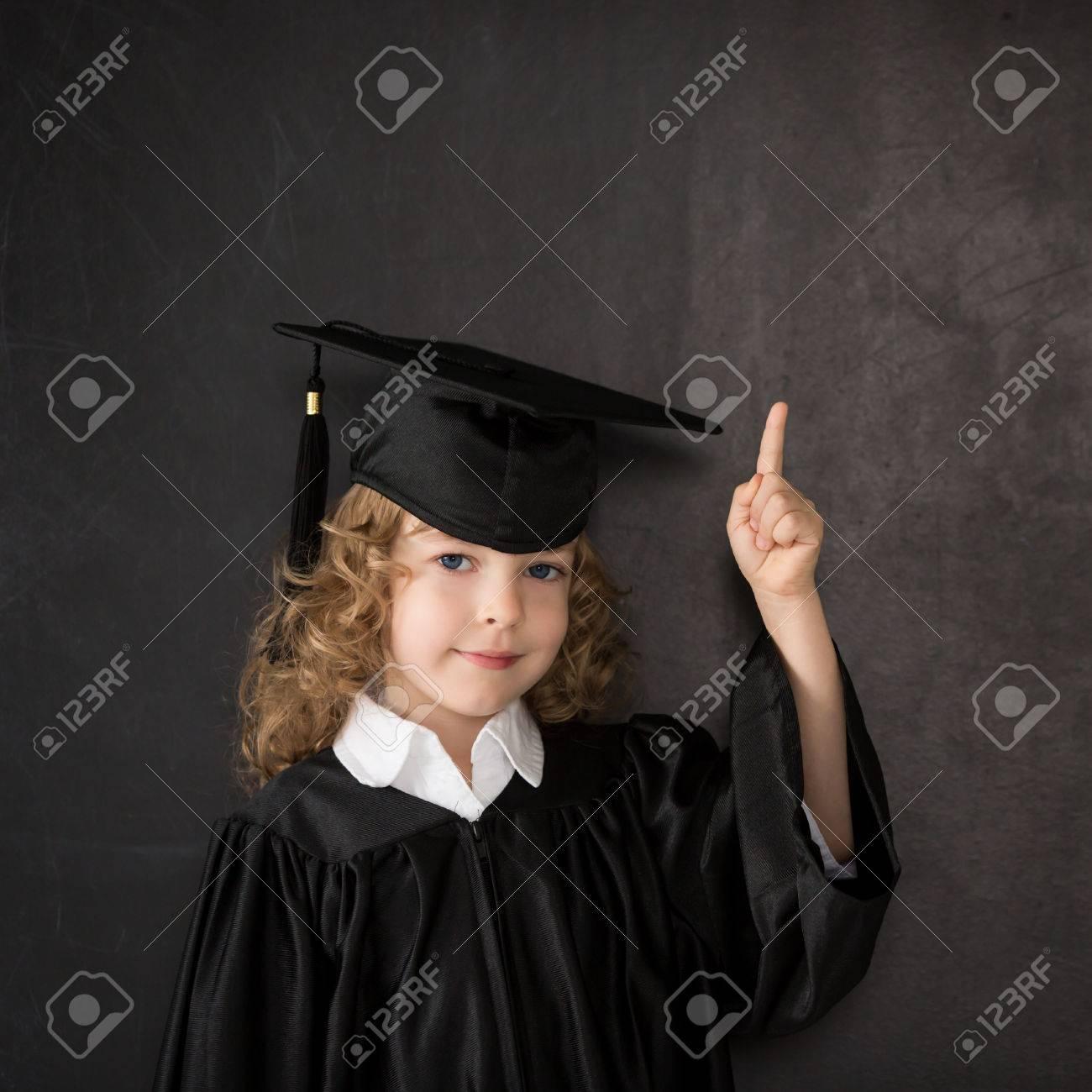 Smart kid in class against blackboard Stock Photo - 30826138