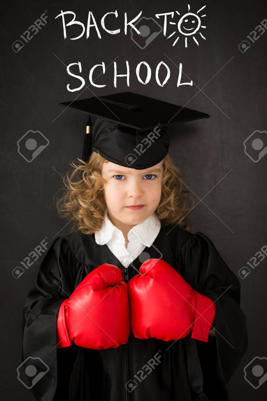 Smart kid in class. Happy child against blackboard. Back to school. Knowledge is power concept Stock Photo - 31127640