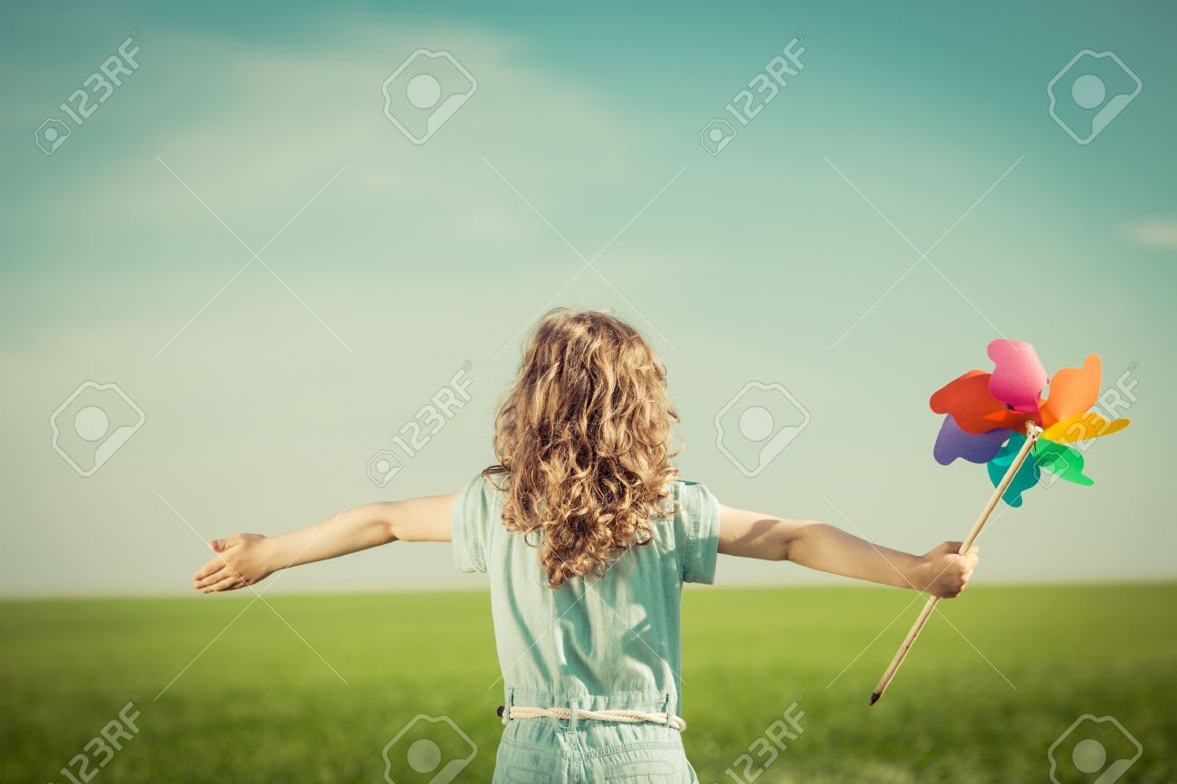 Happy Child In Spring Field. Young Girl Relax Outdoors. Freedom ...