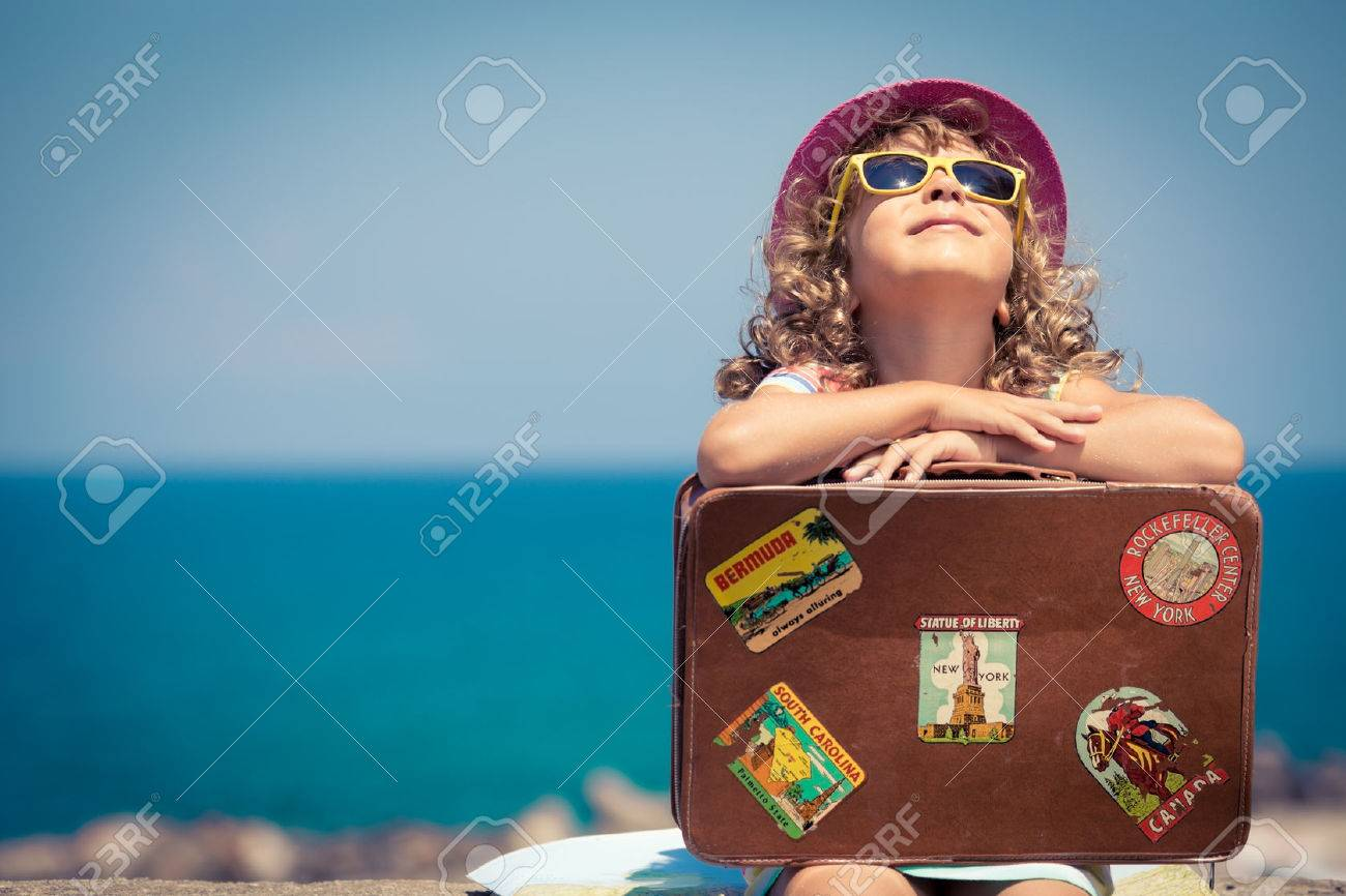 Child with vintage suitcase on summer vacation. Travel and adventure concept - 38259947