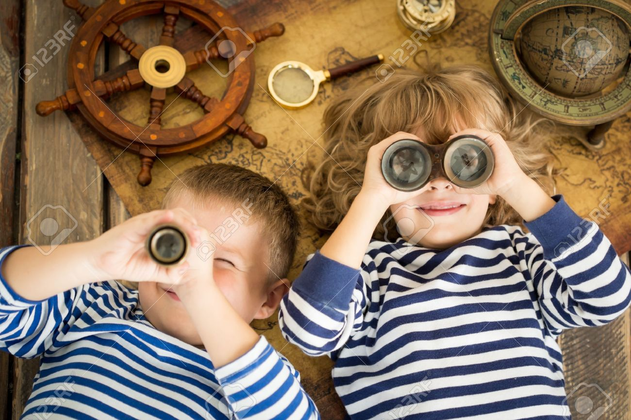 Happy kids playing with nautical things. Children having fun at home. Travel and adventure concept. Unusual high angle view portrait - 38974191