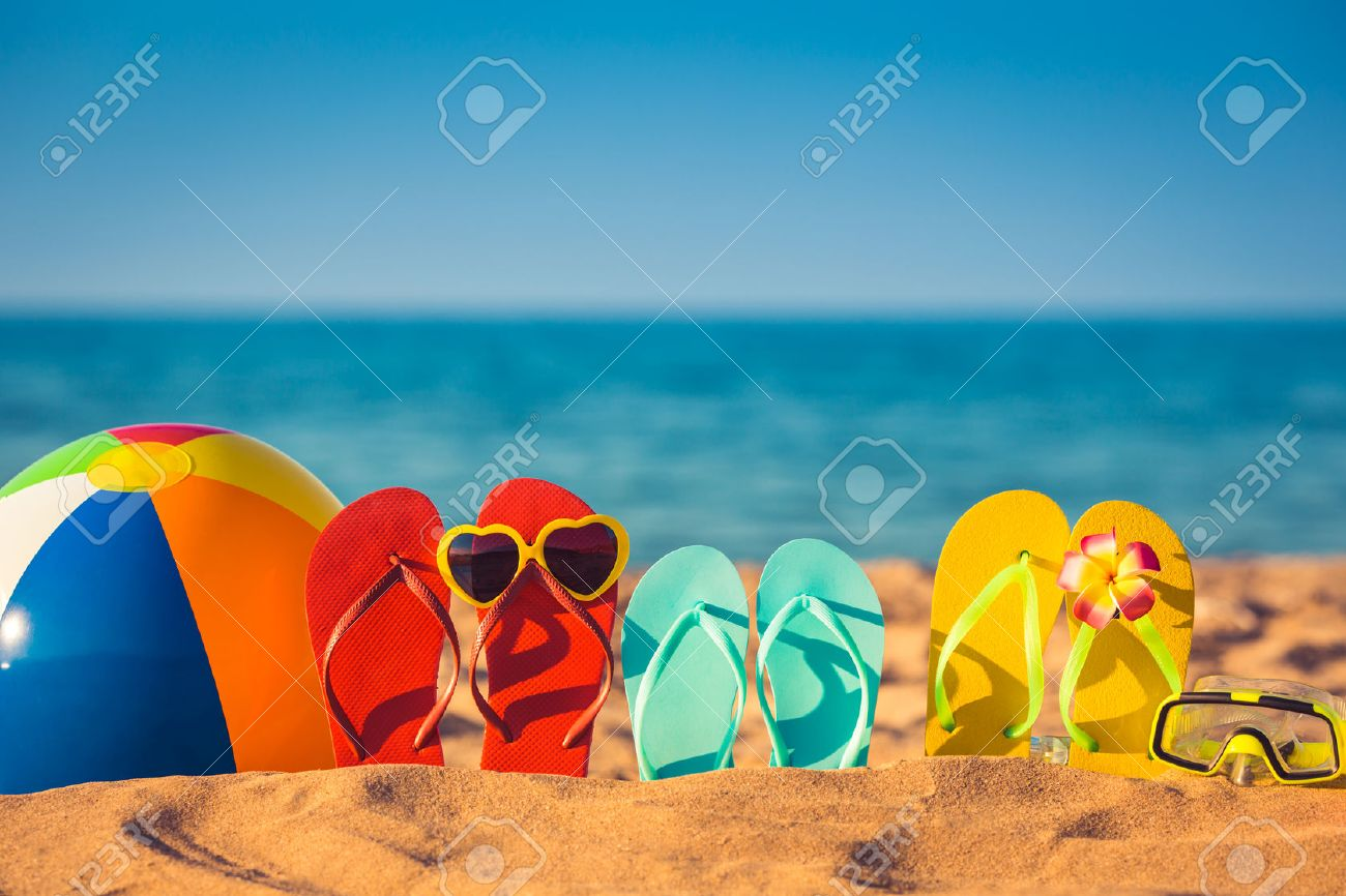 Flip-flops, beach ball and snorkel on the sand. Summer vacation concept - 39736305