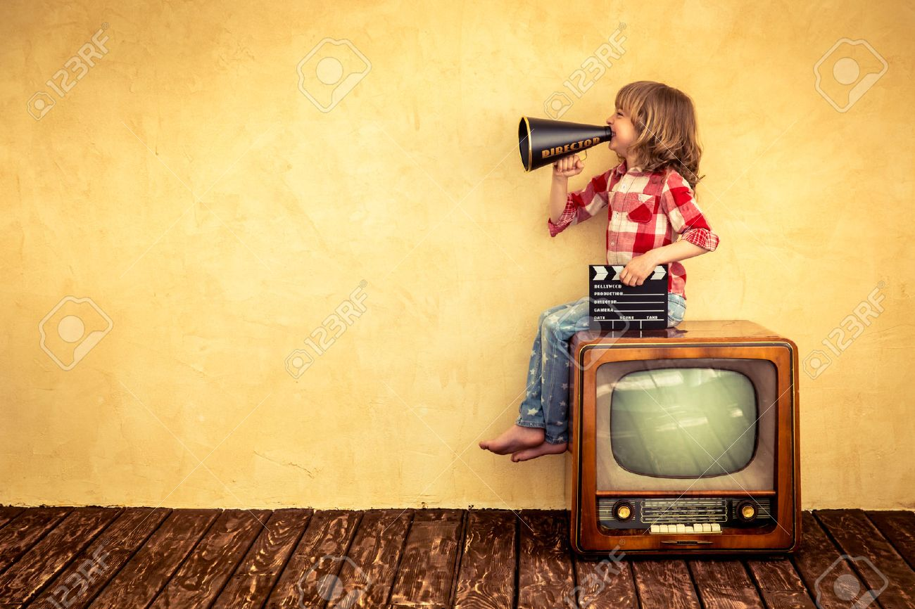 Kid shouting through vintage megaphone. Communication concept. Retro TV Stock Photo - 46080096