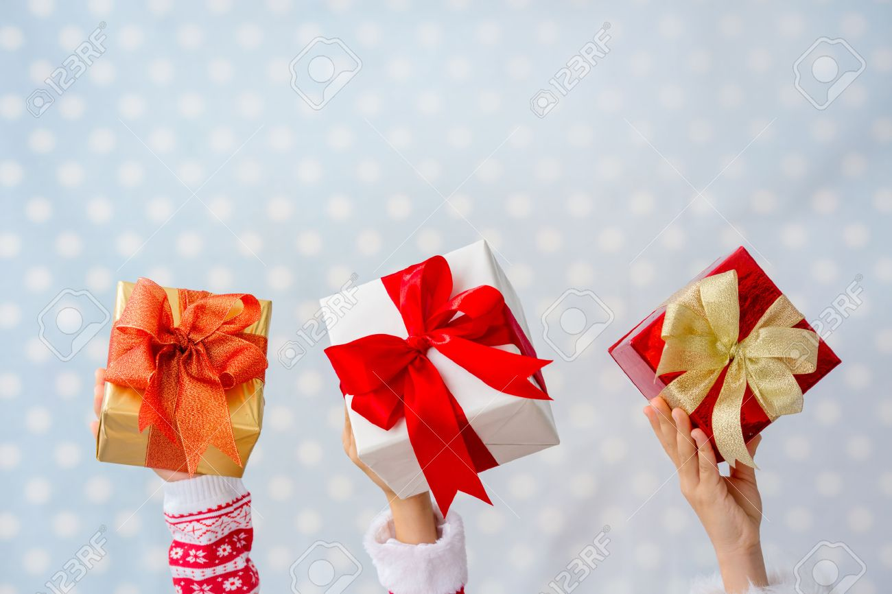 Merry Christmas Children Hands Holding Xmas Gift Boxes Against