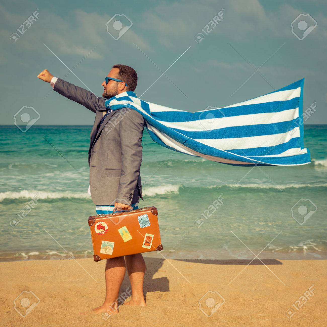 Portrait of funny businessman on the beach. Man having fun by the sea. Summer vacation and travel concept - 54980294
