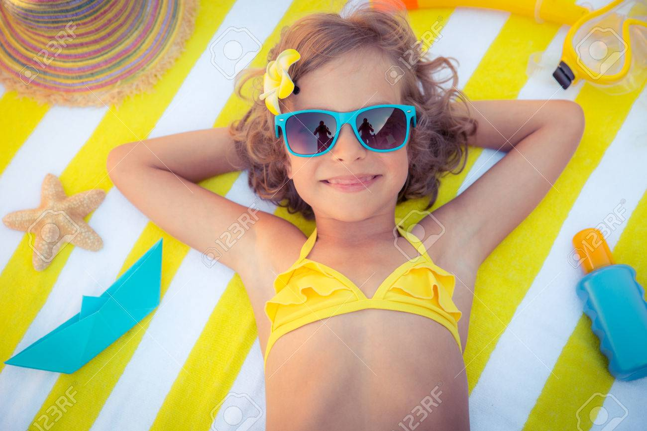 Happy child on the beach. Kid having fun outdoors. Summer vacation concept. Top view portrait - 56405300