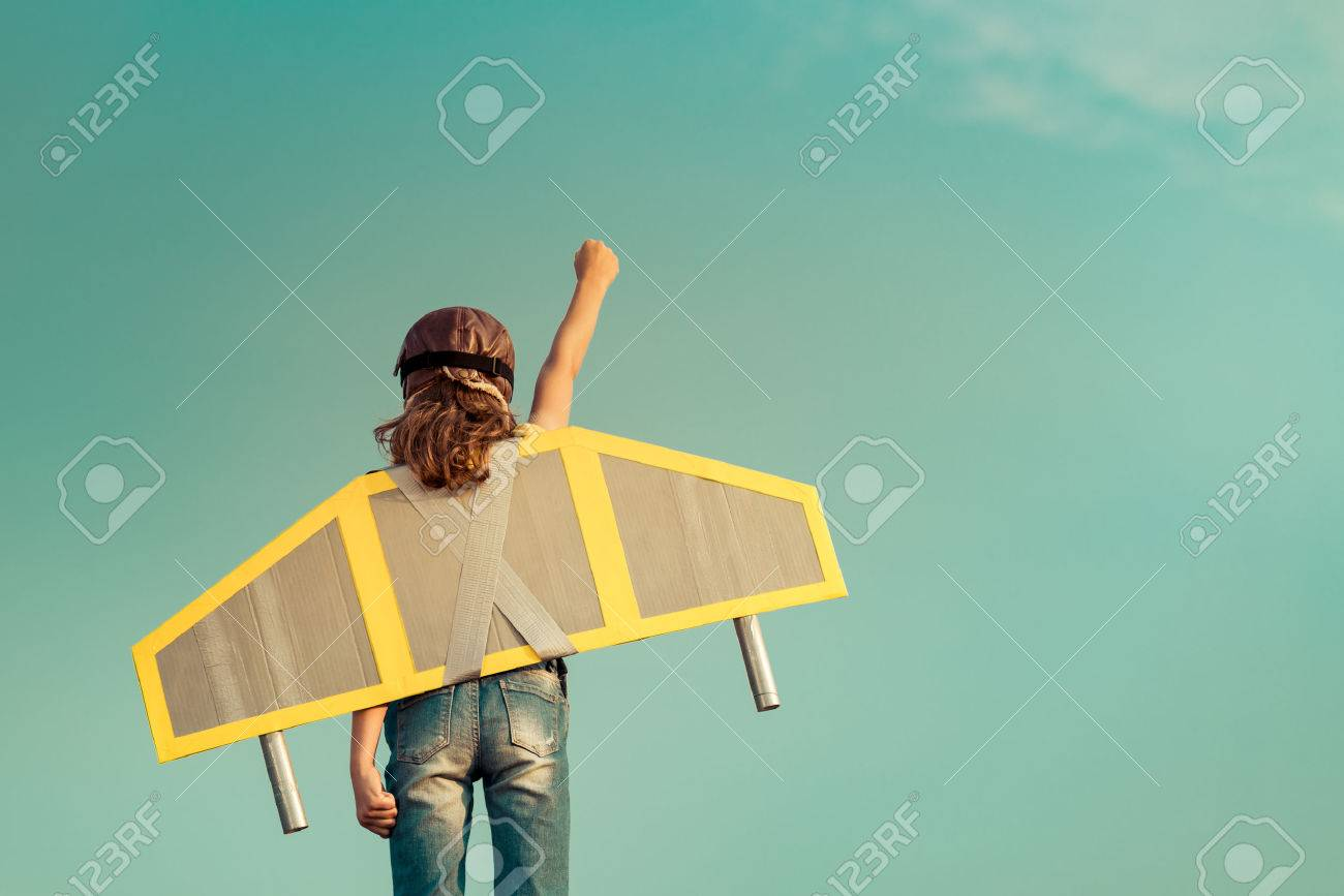 Kid with jet pack pretend to be superhero. Child playing in summer outdoors. Success, leader and winner concept - 61237208