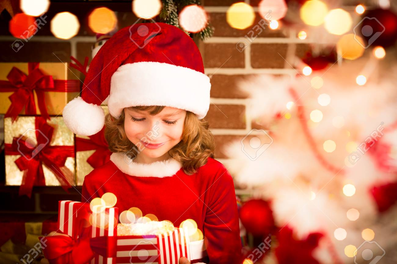 Child Holding Christmas Gift. Kid Having Fun At Home. Xmas Winter ...