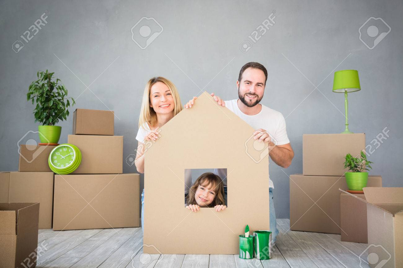 Happy family playing into new home. - 73219288