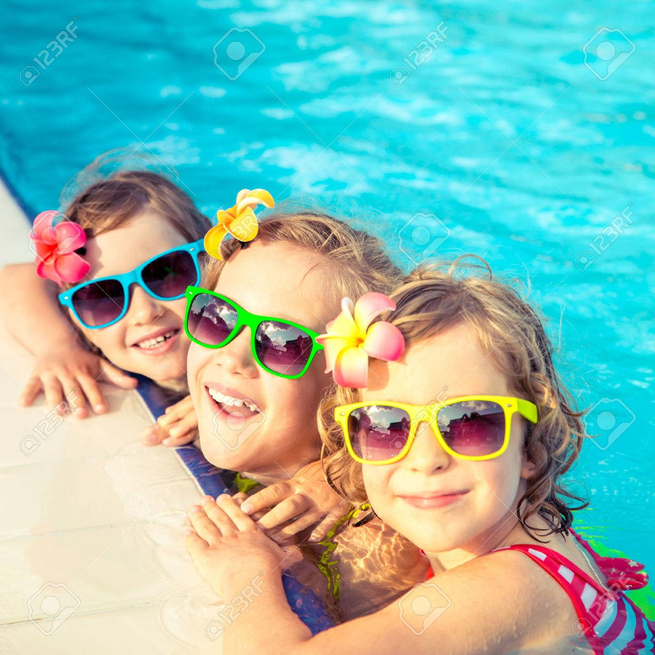 Happy Children In The Swimming Pool. Funny Kids Playing Outdoors ...