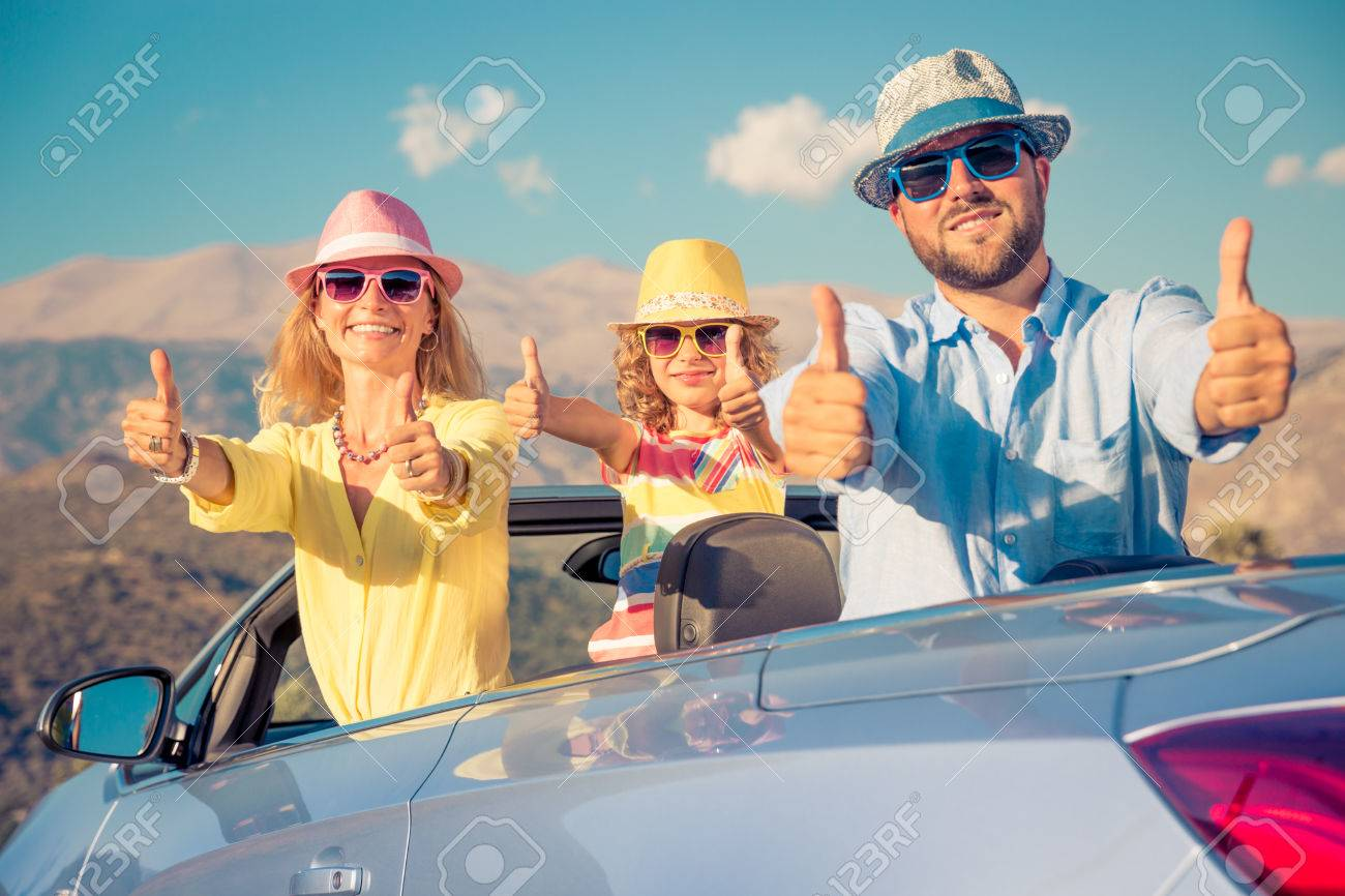 Happy family travel by car. People having fun in the mountains. Father, mother and child on summer vacation. - 78474239