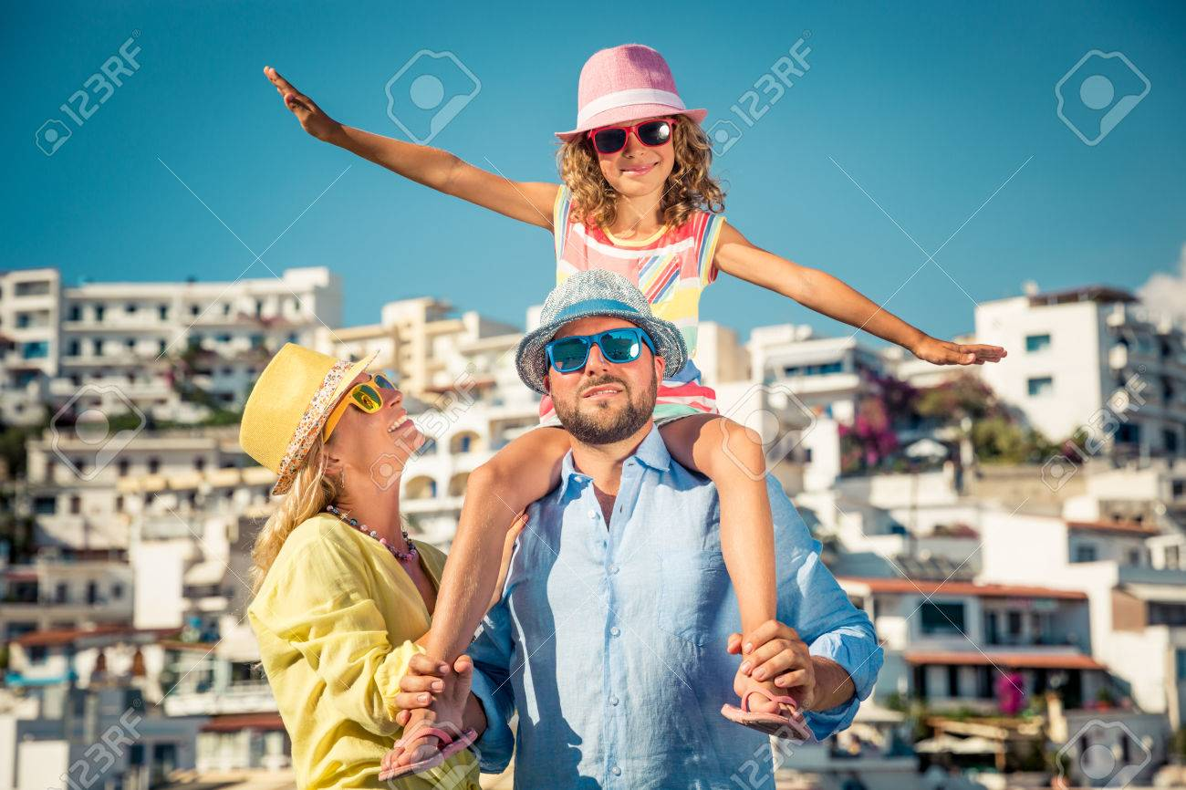 Happy family travelling. People having fun in old european town. Summer holiday and vacation concept - 80327392