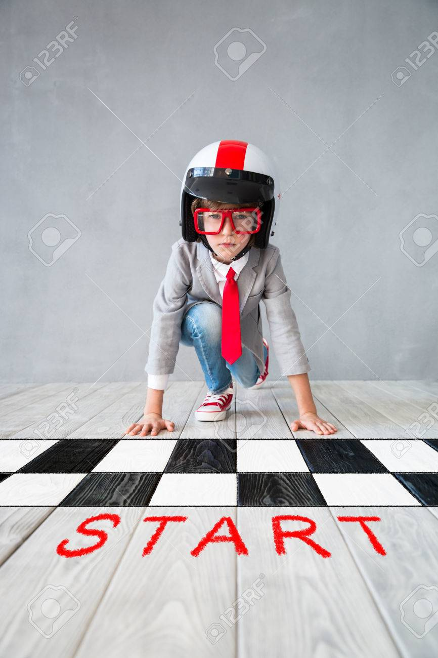 Portrait of young child pretend to be businessman. Kid playing at home. Imagination, idea and creative concept. Copy space for your text - 84399155