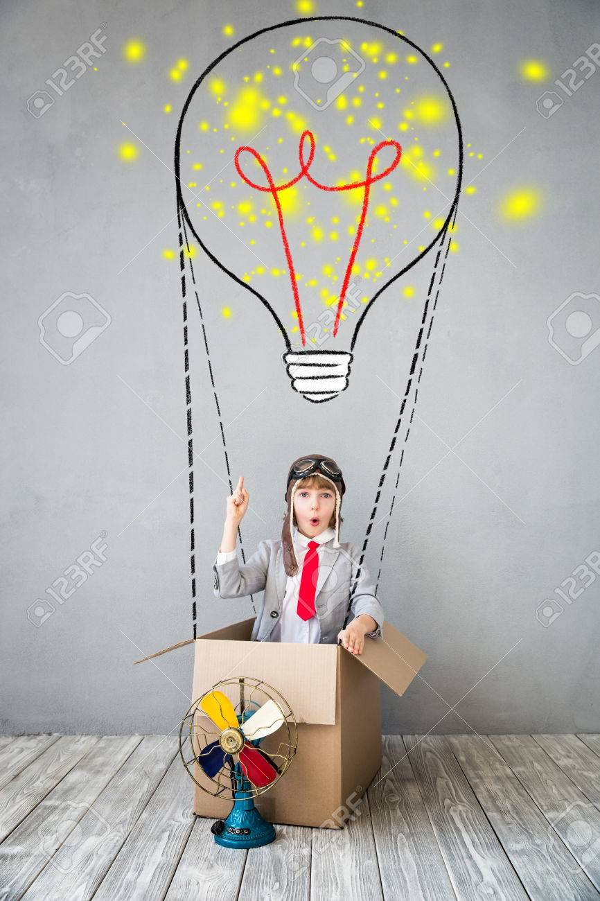 Portrait of young child pretend to be businessman. Kid playing at home. Imagination, idea and creative concept. Copy space for your text - 84399157