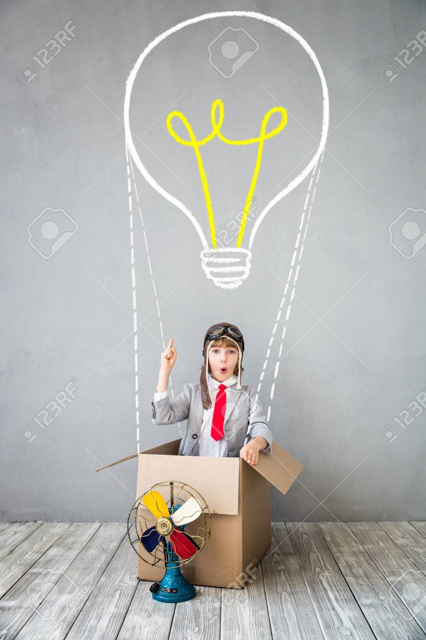 Child pretend to be businessman. Kid playing at home. Imagination, idea and creative concept. Copy space for your text - 84790575