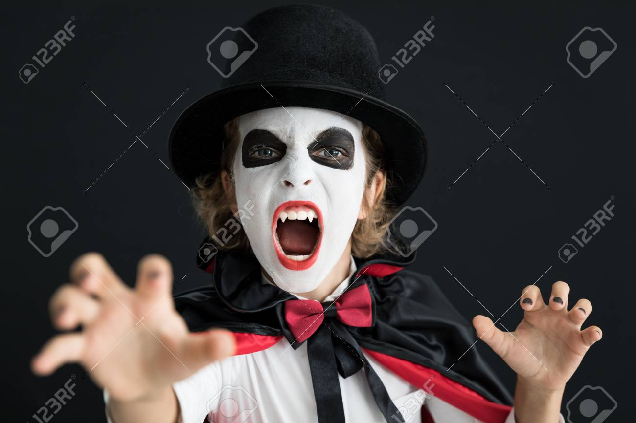 Funny child dressed Halloween costume. Kid painted terrible v&ire. Autumn holiday concept Stock Photo  sc 1 st  123RF.com & Funny Child Dressed Halloween Costume. Kid Painted Terrible Vampire ...