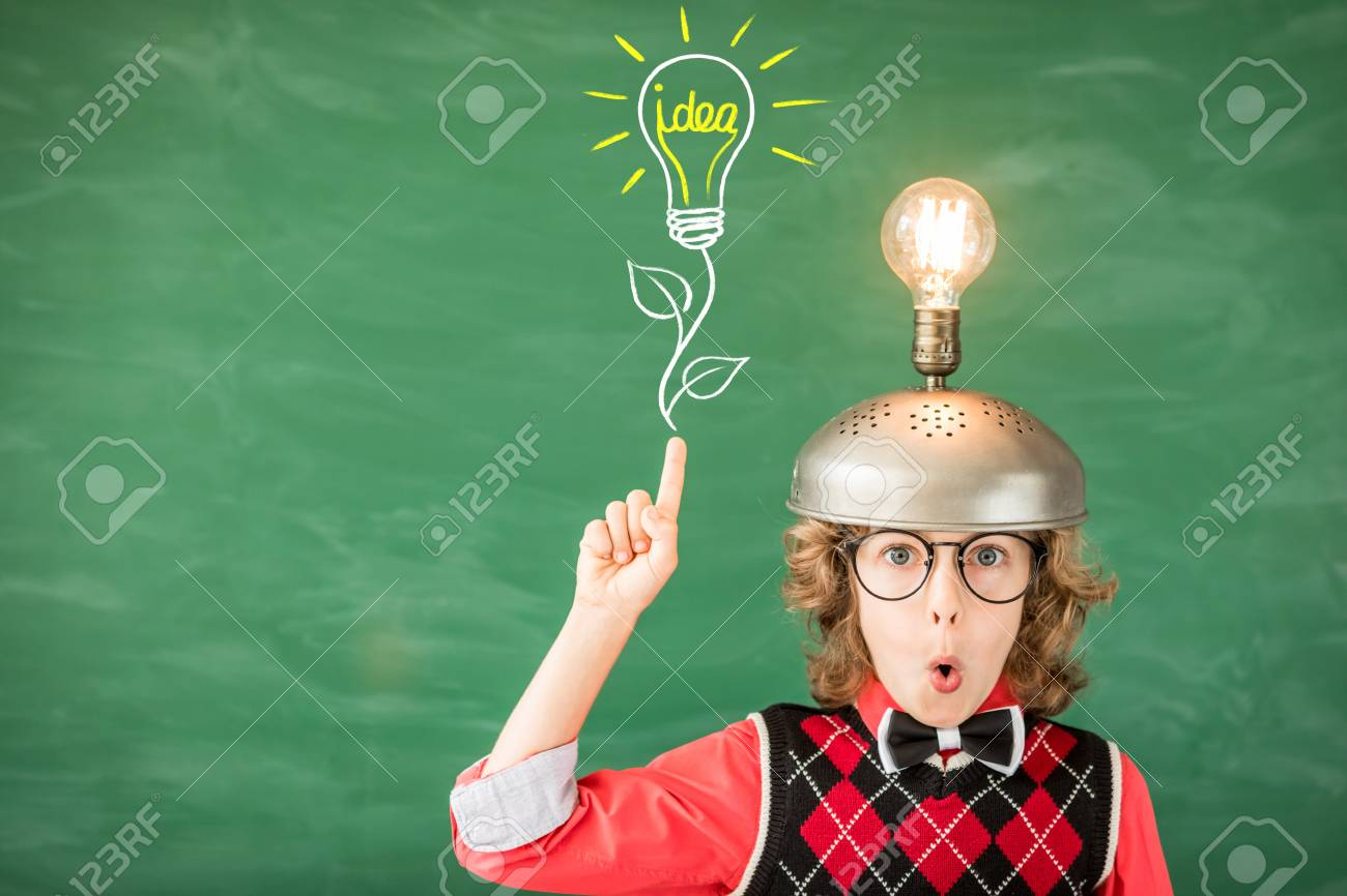 Portrait of child in classroom. Kid with toy virtual reality headset in class. Success, idea and creative concept. Back to school - 86898262