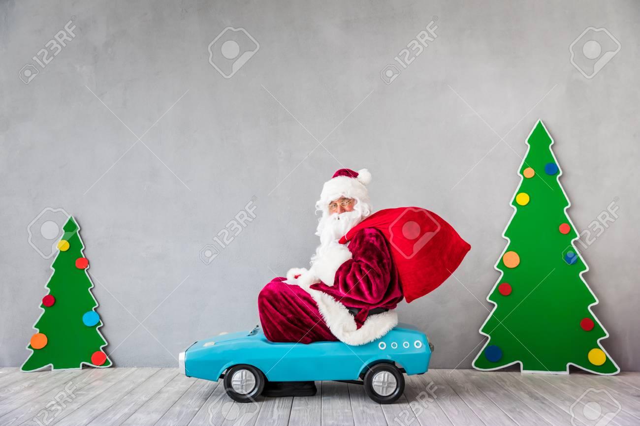 Santa Claus riding car. Christmas Xmas holiday concept - 87916577