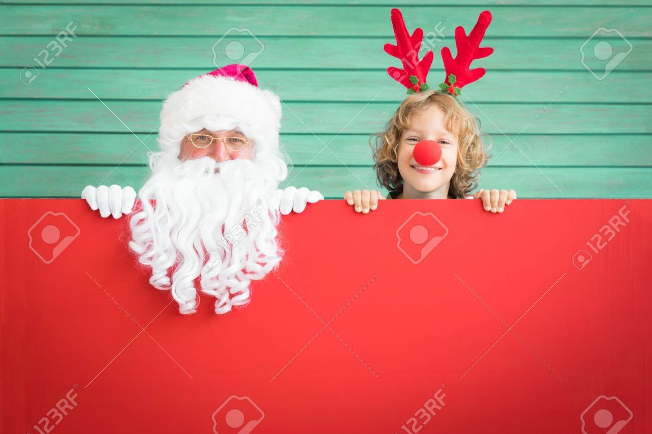 0b8af35bc25a7 Santa Claus and reindeer child holding banner blank. Merry Christmas  greeting card. Xmas holiday