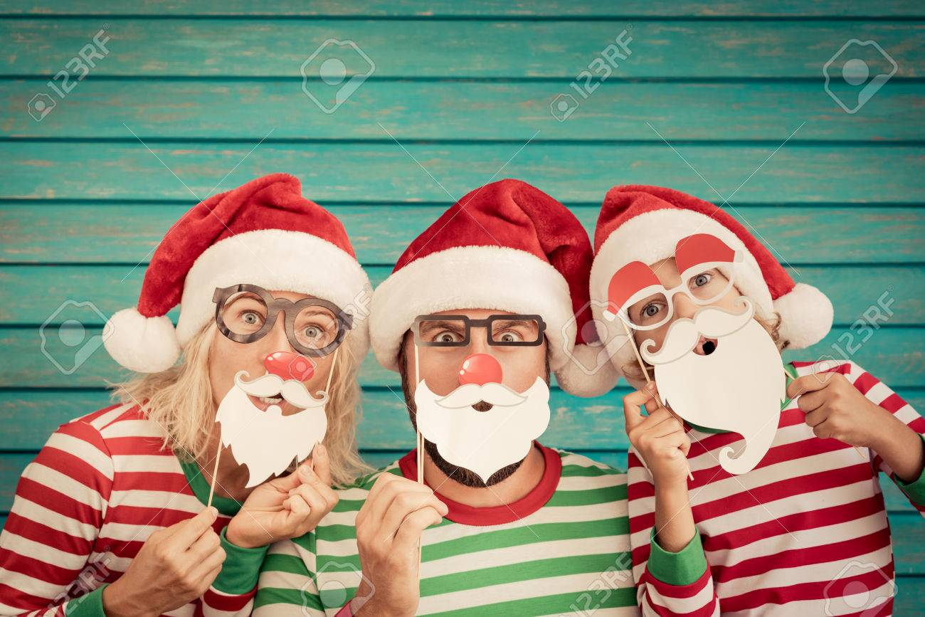 Happy family playing at home. Funny father; mother and child on Christmas eve. Xmas winter holiday concept - 88766912