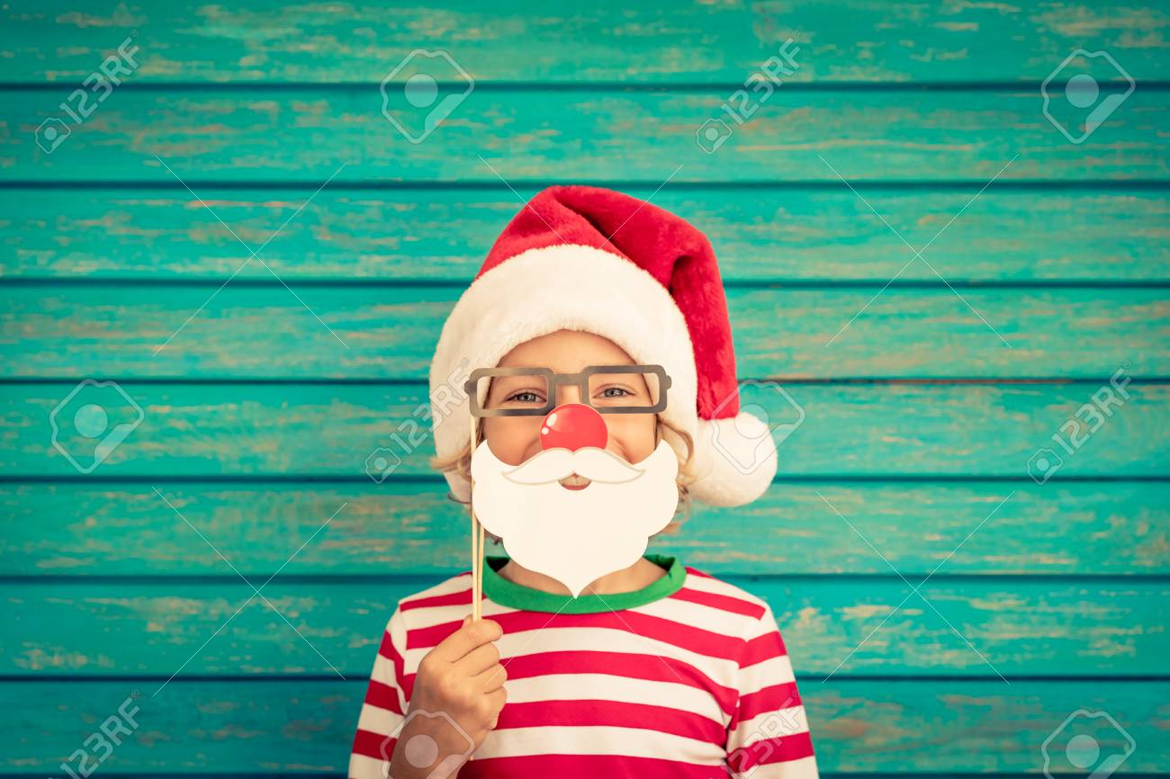 Happy child playing at home. Funny kid on Christmas eve. Xmas winter holiday concept - 89325357