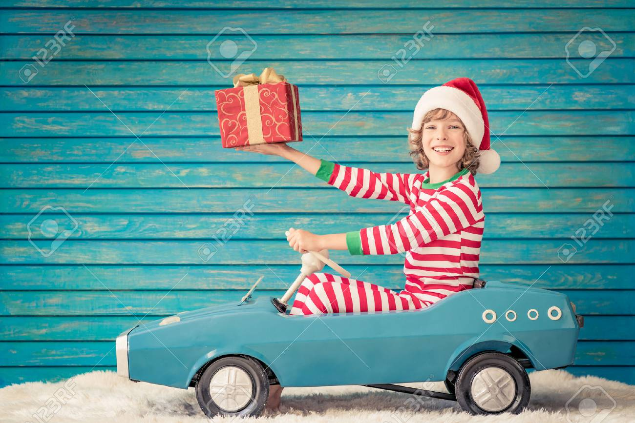 Happy child playing at home. Funny kid on Christmas eve. Xmas winter holiday concept - 89791683