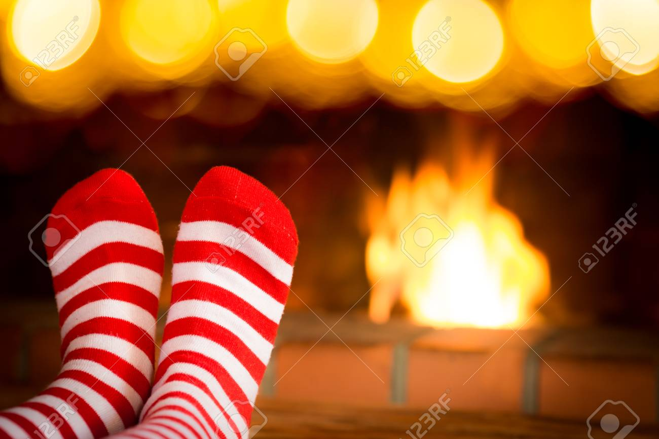Child In Christmas Socks Near Fireplace. Kid Relaxing At Home ...