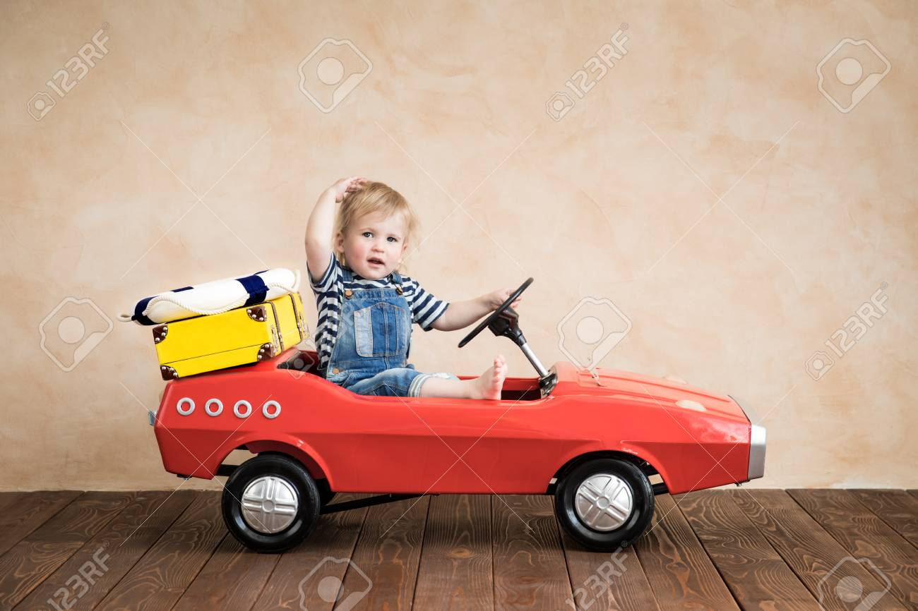 Child playing at home. Summer vacation and travel concept - 102907124