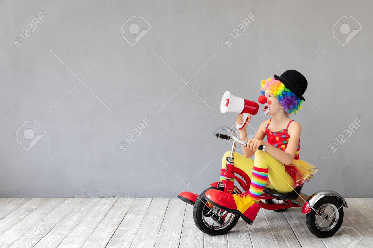 Funny kid clown. Happy child playing at home. 1 April Fool's day concept - 115343774
