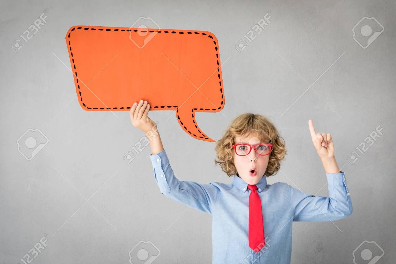 Happy child holding paper speech bubble blank. Success, creative and idea concept - 116468455