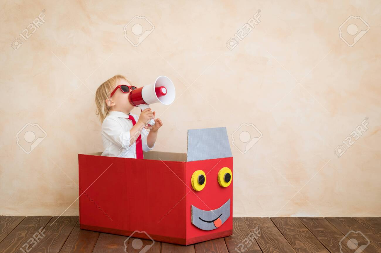 Happy child pretend to be businessmen. Funny kid speaking by megaphone. Education, start up and business idea concept - 120897166